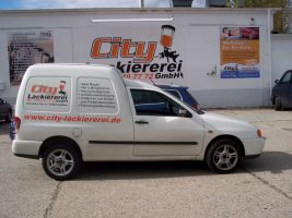 438 VW Caddy Werbung City Lackiererei